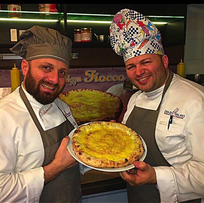 Salvatore_e_Roberto_Susta_volano_conla_pizza_Fiocco_negli__USA