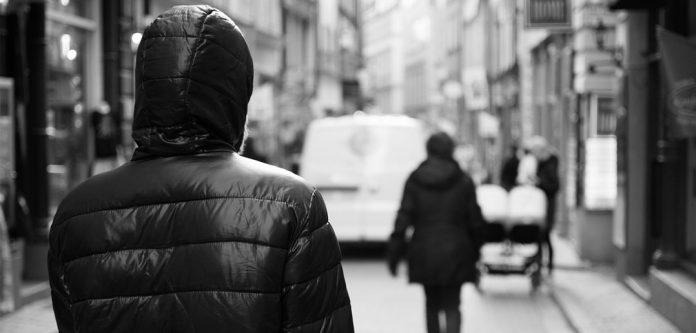 Man-stalking-a-woman-by-Patrik-Nygren-CC-BY